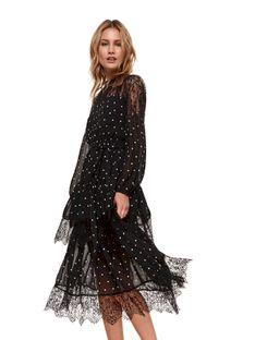 Sukienka w groszki z koronkowymi wstawkami