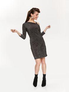 Błyszcząca sukienka odkrywająca ramię