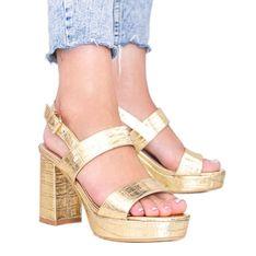 Złote metaliczne sandały na słupku w motywie zwierzęcym Liv złoty